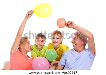 cute boys with grandparents posing on white