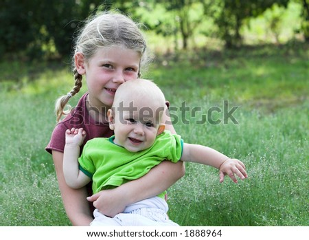 Cute brother and sister pair outdoors