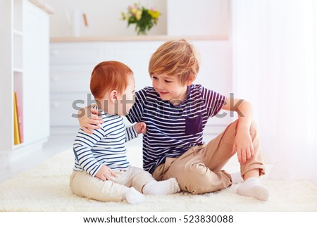 cute brothers playing together at home