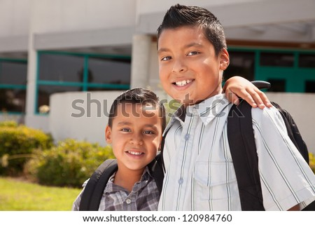 Cute Brothers Wearing Backpacks Ready for School. - stock photo