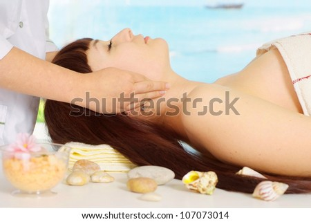 Cute brunette doing massage at the spa - stock photo