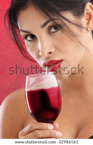 Cute brunette holding a glass of red wine