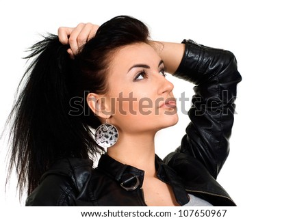 Cute brunette in a leather jacket masterfully poses for photos