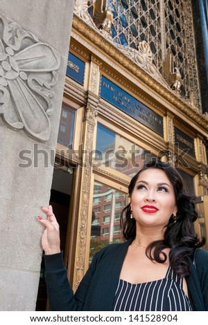 Cute brunette outside post office, NYC - stock photo