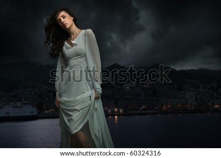 Cute brunette over city background - stock photo