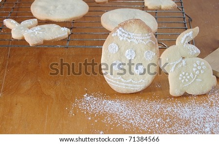 Cute Bunny and Egg Easter Cookies with Icing Sugar Designs - stock photo