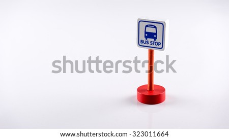 Cute Bus Stop sign on wooden post pole. Concept of traffic road sign. Isolated on white background. Slightly de-focused and close-up shot. Copy space. - stock photo