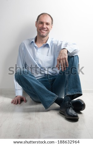 Cute business man in a light interior - stock photo