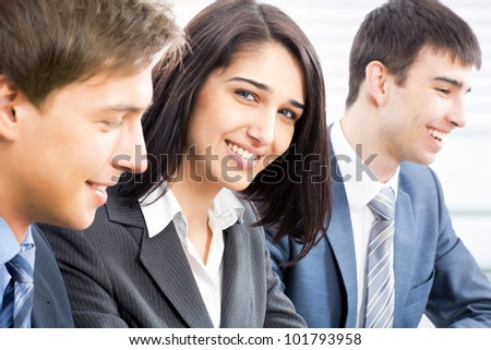Cute business woman with colleagues - stock photo