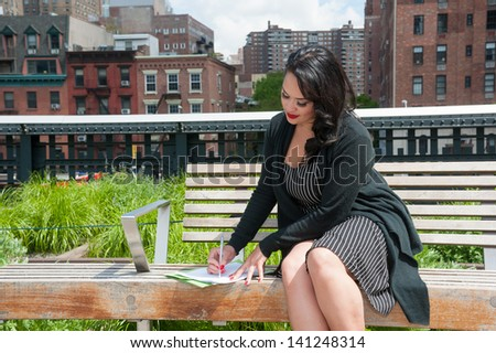Cute business woman working on High Line, NYC - stock photo