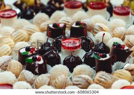 Cute candybar with various candies and cakes. Wedding sweets