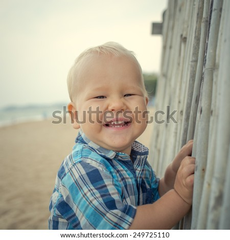 Cute caucasian baby laughing. Outdoor portrait - stock photo