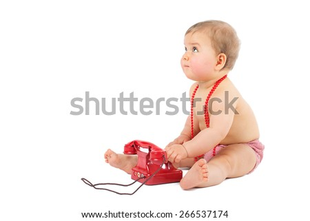 Cute caucasian baby playing with telephone isolated on a white background - stock photo