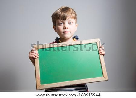 Cute Caucasian Boy Holding Blank Chalkboard  - stock photo