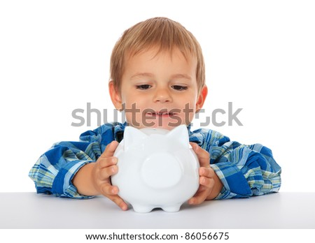 Cute caucasian boy holding piggy bank. All on white background. - stock photo