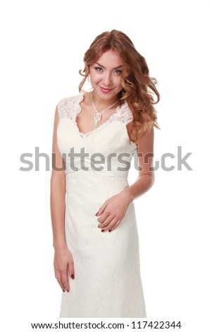 Cute caucasian bride with curly hair is posing on camera - stock photo