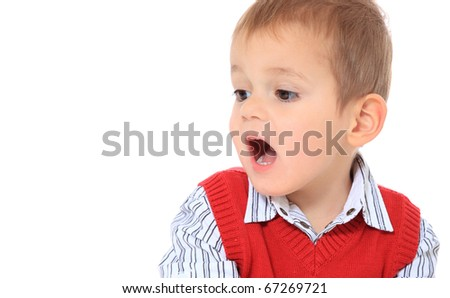 Cute caucasian toddler looking to the side. All isolated on white background. Extra copy space on left side.