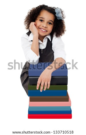 Cute charming kid in school uniform looking at you. - stock photo