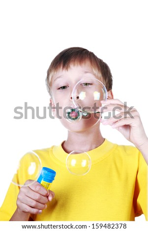 Cute cheerful blond boy in yellow t-shirt with his eyes closed dreaming (isolated on white background) - stock photo