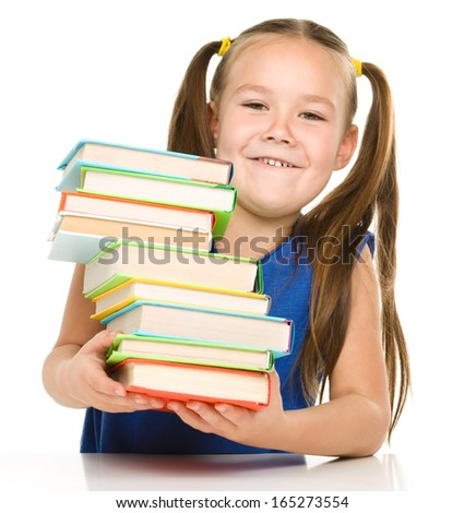 Cute cheerful little girl with books, isolated over white
