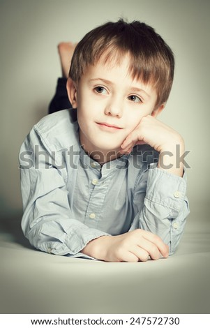Cute child boy dreaming - stock photo