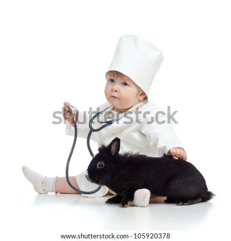 Cute child doctor with pet isolated on white - stock photo