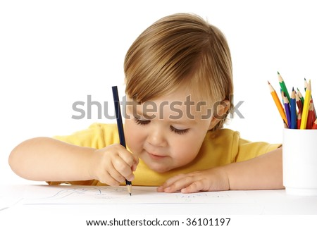 Cute child draw with color crayons, isolated over white