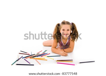 Cute child draw with colorful crayons and smile, isolated over white