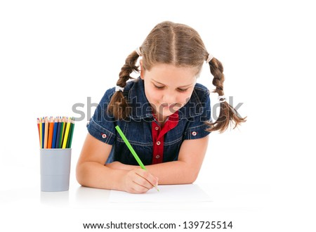 Cute child draw with colorful crayons, isolated over white - stock photo