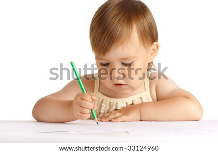 Cute child draw with green crayon, isolated over white