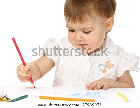 Cute child draw with red crayon