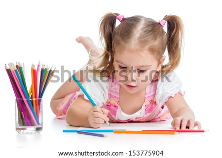 cute child drawing with colorful pencils - stock photo