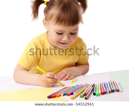 Cute child draws with color felt-tip pens, isolated over white - stock photo