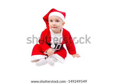 Cute child dressed as Santa Claus and sitting on the floor isolated on white background