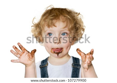 Cute child eating chocolate - stock photo