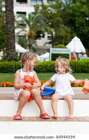 Cute child eating ice cream outdoor - stock photo