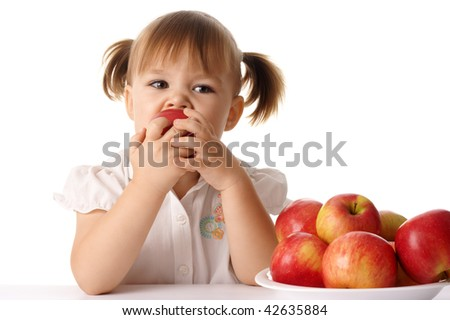 Cute child eats red apple, isolated over white - stock photo
