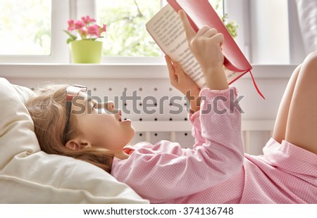 cute child girl reading a book. self learning - stock photo