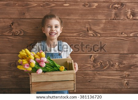 Cute child girl with a bouquet of tulips. Mothers day, spring concept. - stock photo