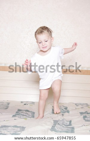 cute child having fun on bed - stock photo