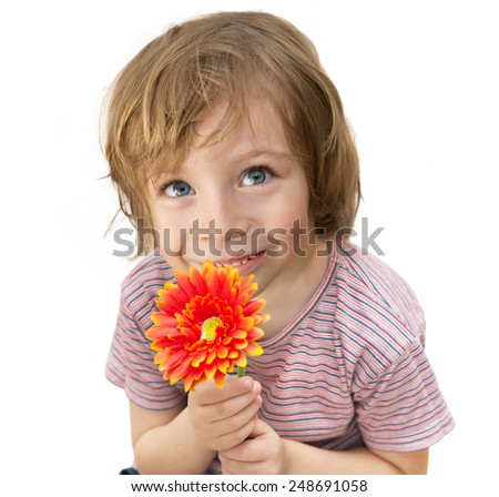 Cute child holding a red flower  - stock photo