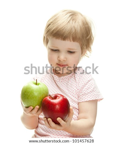 Cute child holding apples looking at them, isolated on white - stock photo