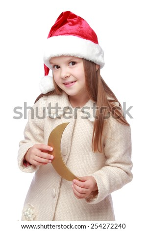 Cute child in a Santa hat with a golden moon