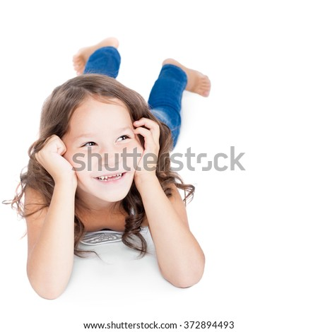 cute child lying on the floor and thinking