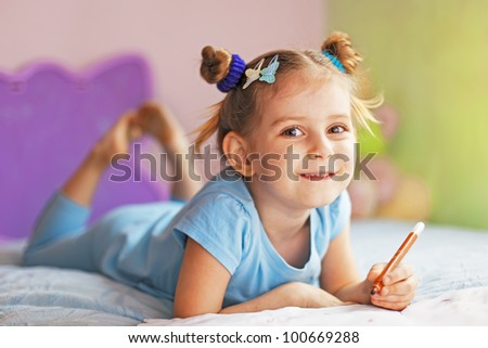Cute child  painting in her nursery at home - stock photo