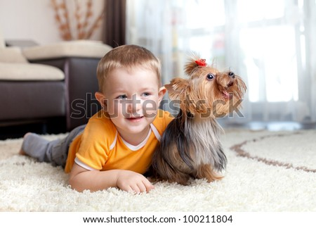 cute child playing and hugging loving dog york