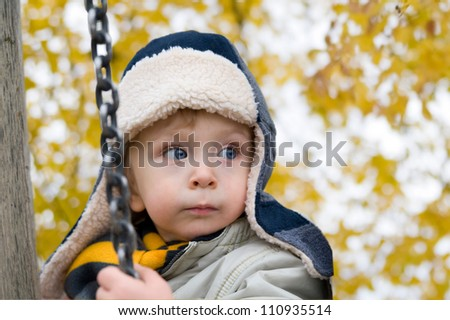 Cute child playing in autumn park