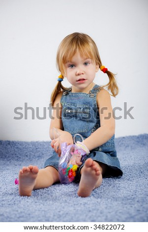 Cute child playing on carpet