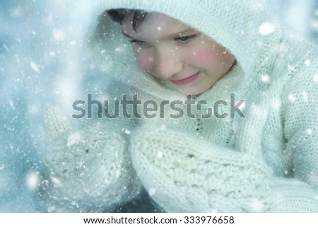 Cute child playing with snow. - stock photo