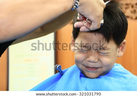 Cute child scared and doesn't like to cut my hair